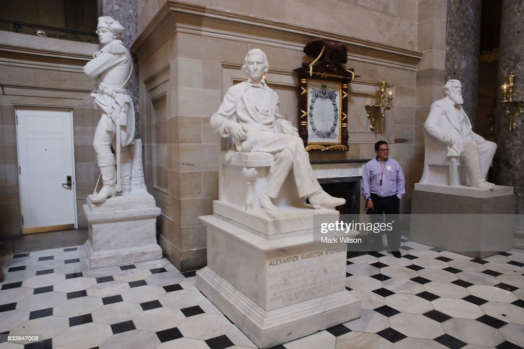 The statue of Alexander Hamilton Stephens (C), who was the Confederate vice president throughout the Civil War, stands inside of Statuary Hall inside the US Capitol August 17, 2017 in Washington, DC. House Minority Leader Nancy Pelosi (D-CA) has called for the removal of all Confederate statues from the United States Capitol.