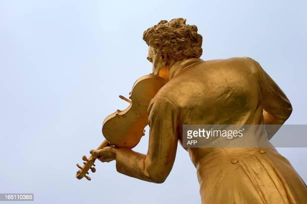 The statue of Austrian music composer Johann Strauss is seen in the Stadtpark gardens in Vienna on March 30 2013 AFP PHOTO / ALEXANDER KLEIN