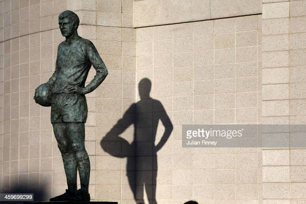 The statue of former Chelsea player Peter Osgood is seen outside the stadium prior to kickoff during the Barclays Premier League match between...