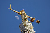 The statue of Justice at The Old Bailey, London. With a sword in one hand and scales in the other this statue of justice on top of the Old Bailey has one difference to many other similar pieces - in this case Justice herself has no blindfold. The sword sta