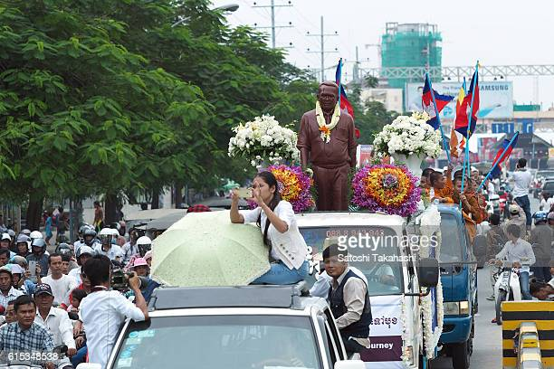 The statue of Kem Ley and thousands of mourners make their way to Ley's home in Takeo province to mark 100 days since his death Kem Ley was shot dead...