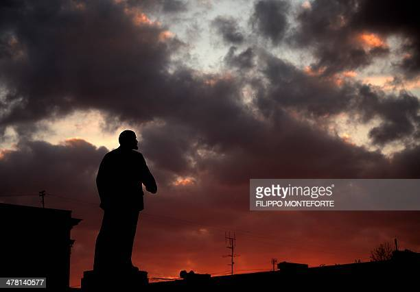 The statue of Lenin is seen at sunset on Lenin's Square in downtown Simferopol on March 12 2014 Russia will mirror any visa sanctions the European...