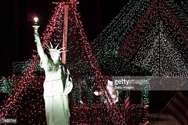 The Statue of Liberty is one of several featured icons in lights at the home of Tony Destro December 18 2002 in Mawah New Jersey Destro puts up the...