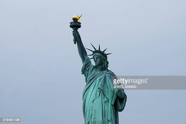 The Statue of Liberty is pictured on July 4 2015 in New York The US is ramping up security across the country and urging people to stay alert over...