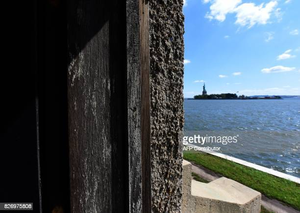 The Statue of Liberty is seen from a room in one of the buildings of the The Ellis Island Hospital on August 5 a 750bed facility which treated over...