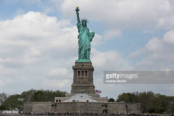 The Statue of Liberty is seen on May 12 2015 in New York City Ellis Island is hosting newiImmigration exhibittitled 'The Journey New Eras of...