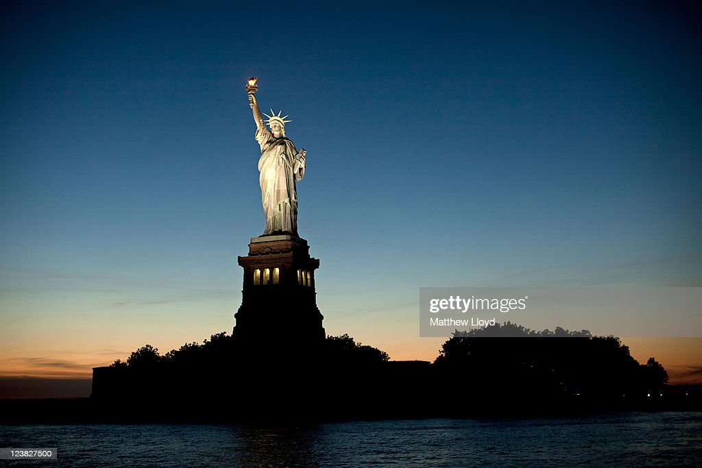 The Statue of Liberty is silhouetted against the setting sun on August 24, 2011 in New York City. New York City, a financial, cultural and tourism centre, has the largest population of any city in the United States.