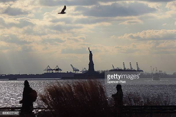 The Statue of Liberty stands in New York Harbor not far from where thousands are attending an rally to protest President Donald Trump's new...