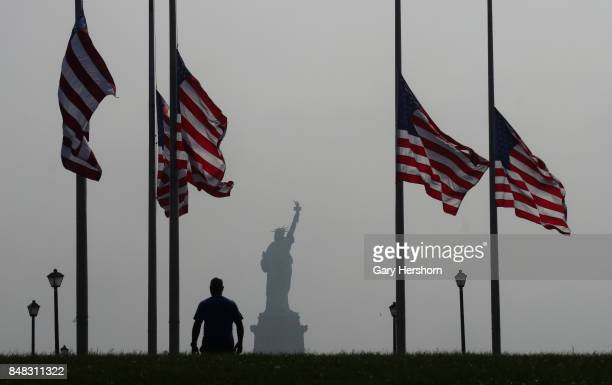 The Statue of Liberty stands in the fog after sunrise on September 16 as seen Liberty State Park in Jersey City NJ