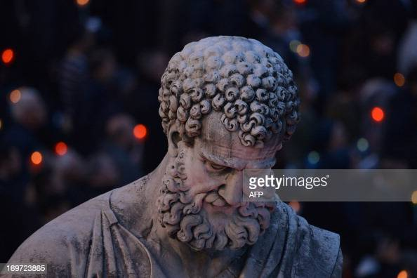 The statue of St Peter is seen as the Rosary concluding Marian month of May is led by the pontiff on May 31 2013 at St Peter's square at the Vatican...