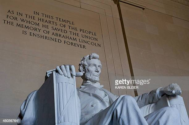 The statue of the 16th president of the US Abraham Lincoln is seen at the Lincoln Memorial on November 19 2013 in Washington DC Today marks the 150th...