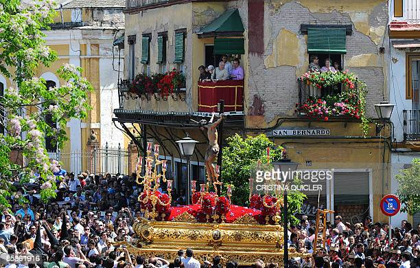 The statue of the Christ of the Welfare is carried during the 'San Bernardo' brotherhood procession during the Holy Week in Sevilla on April 8 2009...