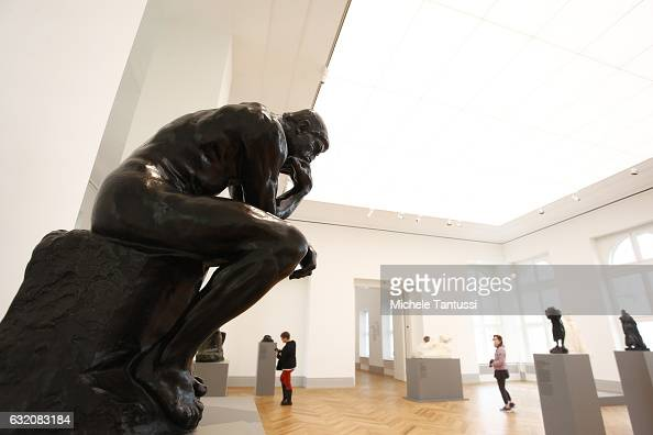 The Statue of the French sculptor Auguste Rodin The Thinker stands as the visitors walk among the museum's exhibition spaces during a press preview...