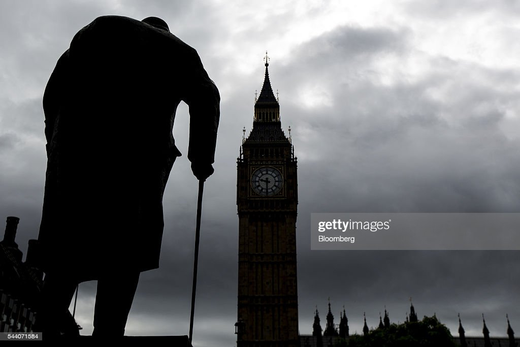 The statue of William Churchill stands silhouetted in Parliament Square, as St Stephen's Tower, commonly known as Big Ben, stands as part of the Houses of Parliament are seen in the background London, U.K., on Friday, July 1, 2016. Michael Gove and Theresa May are the favorites to succeed David Cameron as Conservative leader and premier after his defeat in the European Union referendum forced his resignation. Photographer: Jason Alden/Bloomberg via Getty Images