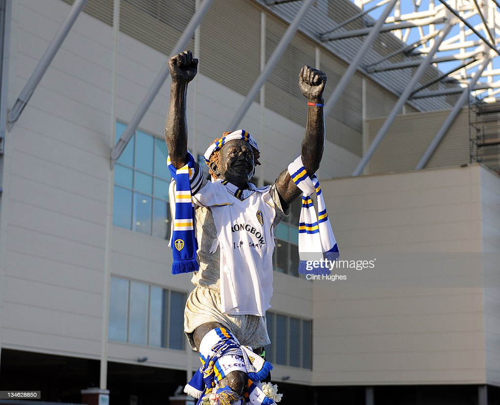 The statue to Leeds United legend Billy Bremner becomes a shrine to the late Gary Speed at the foot of the Billy Bremner statue prior to kick off during the npower Championship match between Leeds United and Millwall at Elland Road on December 03, 2011 in Leeds, England.