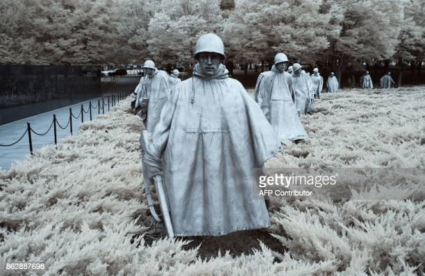 The statues of soilders are seen at the Korean War memorial in Washington DC on August 31 2017 / AFP PHOTO / Andrew CABALLEROREYNOLDS