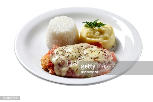 The steak parmigiana with potato and rice : Stock Photo