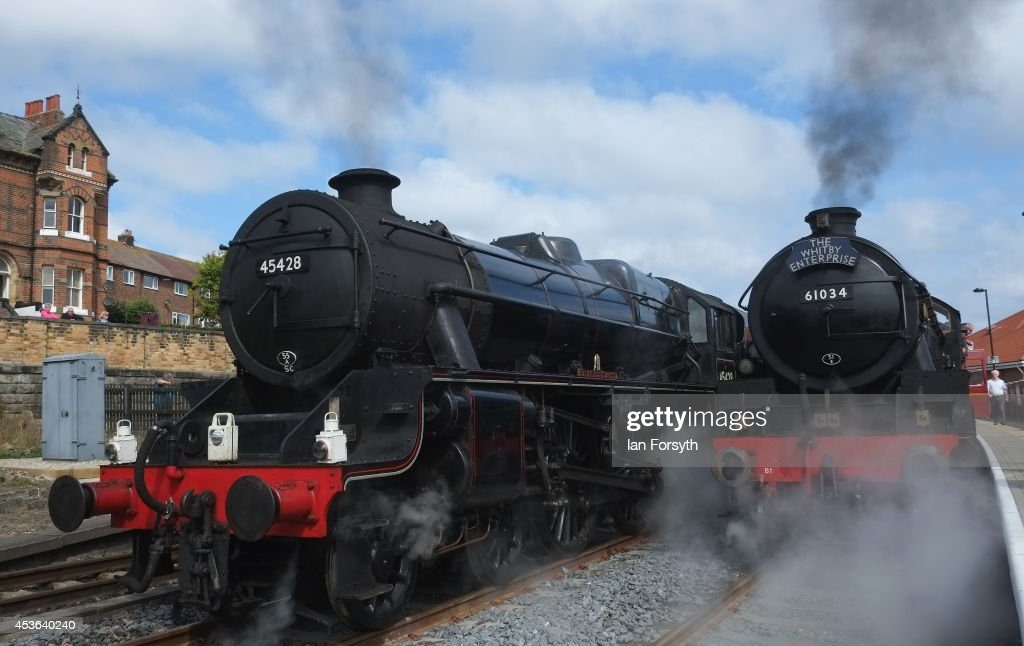 The steam locomotives 'Eric Treacy' (L) and 'Chiru' sit together at Whitby train station during a ceremony to mark a second platform opening at the station on August 15, 2014 in Whitby, England. The second platform will provide passengers with more options for travel to the Yorkshire seaside town on the North Yorkshire Moors Railway and was the first time in half a century two steam locomotives were side by side at the station.