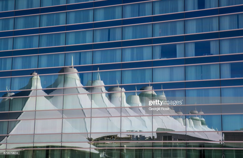 The Steel And Fabric Main Terminal Tent Roof Is Reflected On The Outside  Glass Of The