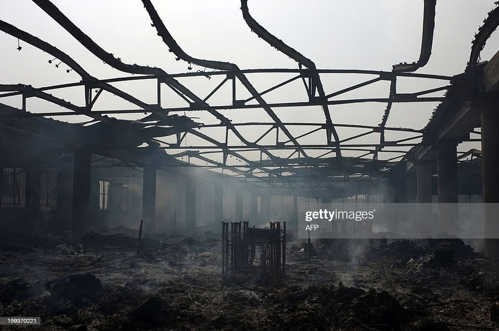The steel frames of sewing machines are all that remain in this section of Lome's Grand Marche (''Big Market'') on January 12 after it was engulfed in flames late on January 11. The market contained many cloth and household goods vendors. AFP Photo / Daniel Hayduk