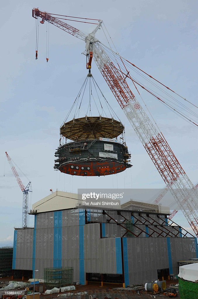 The steel plate, for setting inside the nuclear reactor containment, is unloaded by a special crane to nuclear reactor building at a construction site of Oma Nuclear Power Plant on October 10, 2012 in Oma, Aomori, Japan. Electric Power Development Co. also known as J-Power resumed its construction on October 1, for the first time since the Fukushima Daiichi Nuclear Power Plant accident.