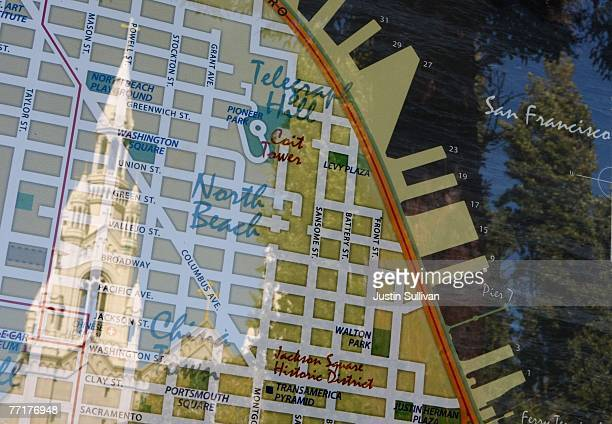 The Steeple of Saints Peter and Paul Church as seen reflected in a map of San Francisco October 3 2007 in the North Beach neighborhood of San...