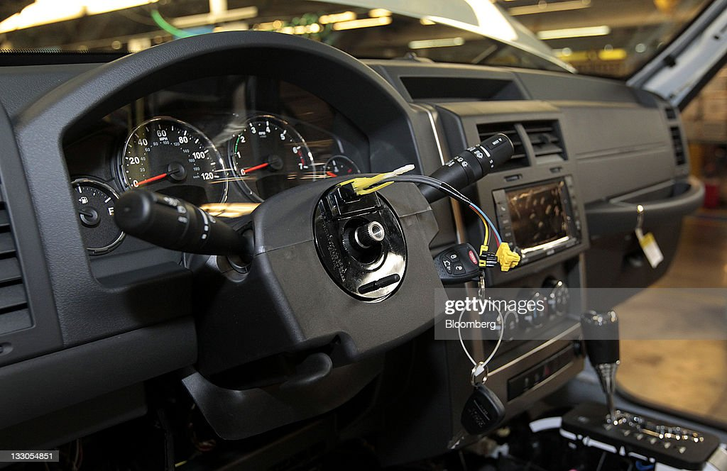 The steering column of the Jeep Liberty is seen as the vehicle moves down the production line at Chrysler's Toledo Assembly Complex in Toledo, Ohio, U.S., on Wednesday, Nov. 16, 2011. Chrysler Group LLC said it will invest $1.7 billion to update a Jeep sport-utility vehicle and add a second shift at its factory in Toledo in the third quarter of 2013. Photographer: Jeff Kowalsky/Bloomberg via Getty Images