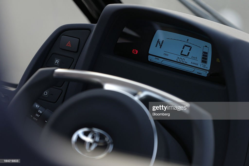 The steering wheel and dashboard of a Toyota Motor Corp. i-ROAD electric personal mobility vehicle (PMV), are seen during a media briefing on the company's advanced technologies in Tokyo, Japan, on Thursday, Oct. 10, 2013. Toyota, the worlds largest automaker, will introduce systems in about two years enabling cars to communicate with each other to avoid collision. Photographer: Kiyoshi Ota/Bloomberg via Getty Images