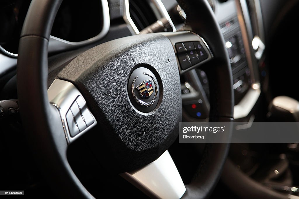 The steering wheel of a General Motors Co. Cadillac SRX sports utility vehicle (SUV) is seen at a dealership in Shanghai, China, on Friday, Feb. 8, 2013. China's services industries grew at the fastest pace since August as gains in retailing and construction aid government efforts to drive a recovery in the world's second-biggest economy. Photographer: Tomohiro Ohsumi/Bloomberg via Getty Images