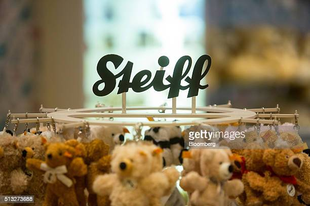 The Steiff logo sits above a teddy bear display inside the gift shop at the Steiff GmbH stuffed toy factory in Giengen Germany on Tuesday March 1...