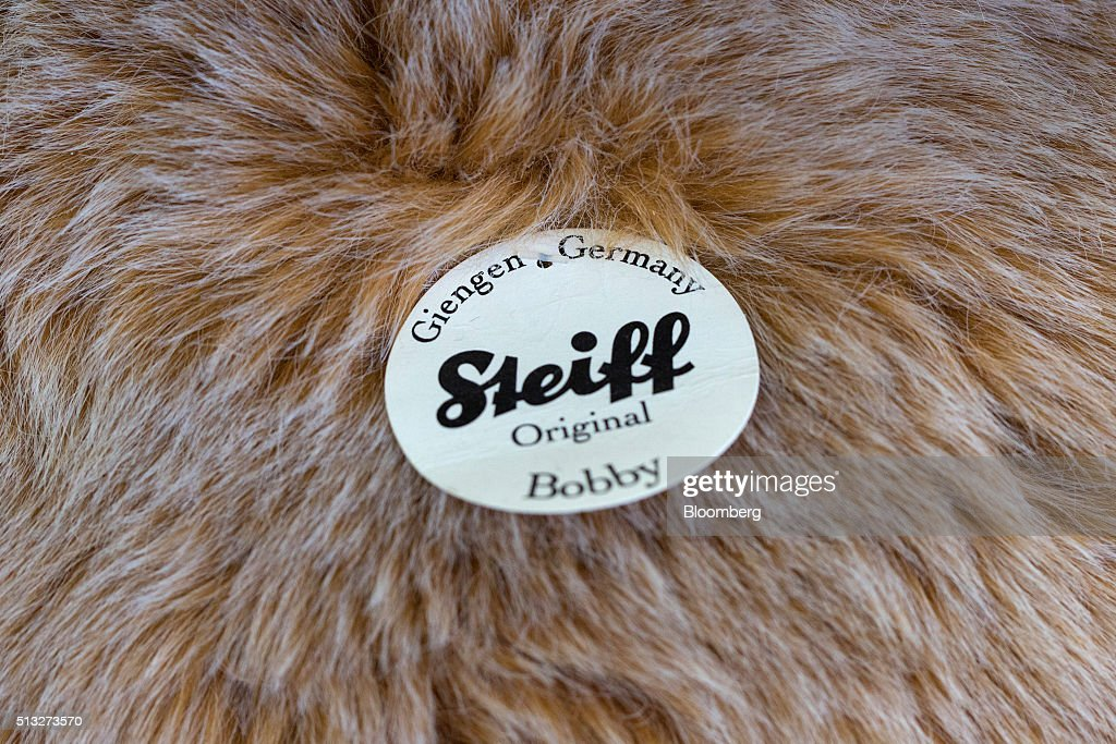 The Steiff logo sits on a label attached to a teddy bear inside the Steiff GmbH toy factory in Giengen Germany on Tuesday March 1 2016 The...