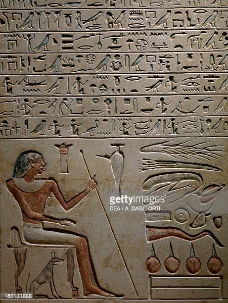 The Stele of Samontuweser depicting the deceased sitting on a stool with a stick in his hand ampoule of lustral water and food supply limestone...