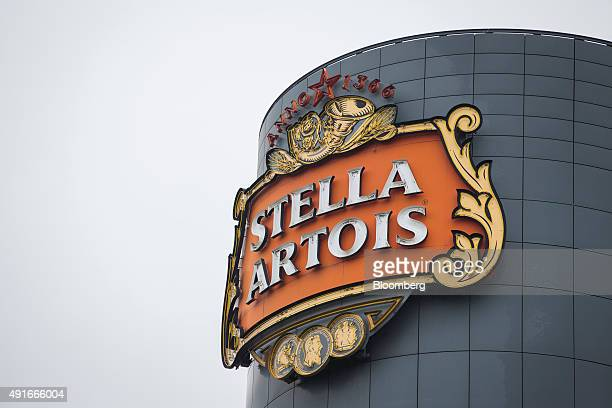 The Stella Artois logo sits on the exterior of the lager beer brewery operated by AnheuserBusch InBev NV in Leuven Belgium on Wednesday Oct 7 2015...