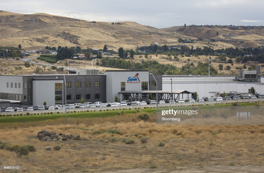 The Stemilt Growers headquarters building stands in Wenatchee, Washington, U.S., on Wednesday, Sept. 20, 2017. Smoke from wildfires in the Cascade Mountains troubled pear pickers in the Wenatchee Valley and Northcentral Washington in mid September. However it benefits the fruit by cooling down temperatures and tends to delay maturity. Photographer: David Ryder/Bloomberg via Getty Images