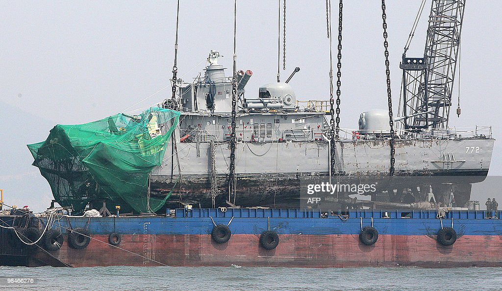 The stern of a South Korean warship is placed on a barge on April 15 after a giant crane lifted it from the seabed near a disputed Yellow Sea border...