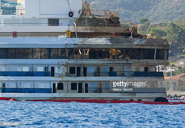 The stern of the Costa Concordia of which several floors remain underwater is seen in upright position on September 18 2013 in Isola del Giglio Italy...