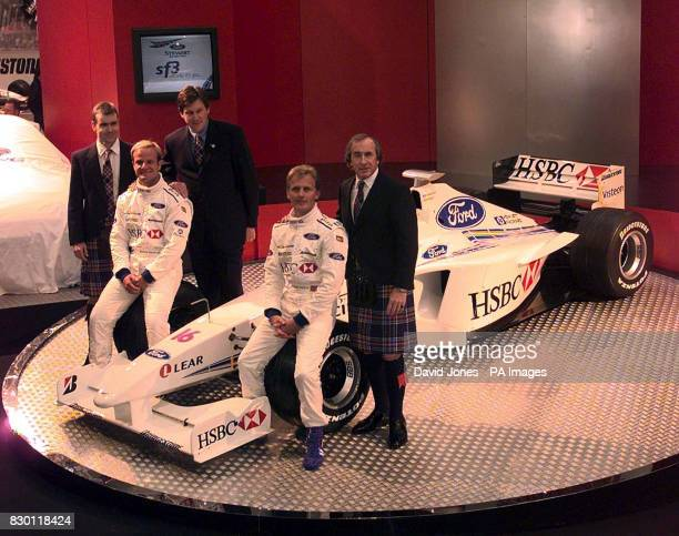 The Stewart Formula 1 team unveil their car and driver lineup for 1999 at the NEC Birmingham today Drivers Rubens Barrichello and Johnny Herbert with...