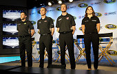 The StewartHaas Race Team poses for photographers during the NASCAR Sprint Media Tour at the Charlotte Convention Center on January 27 2015 in...