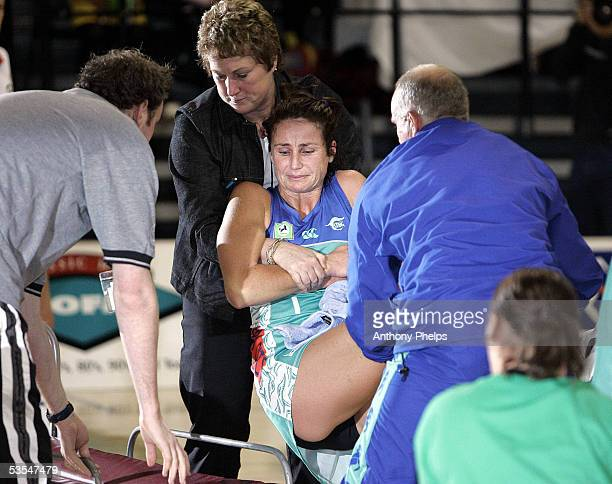 The Stings' Tania Dalton is helped from the court on a stretcher after slipping and hurting her leg during the National Banks Cup netball match...