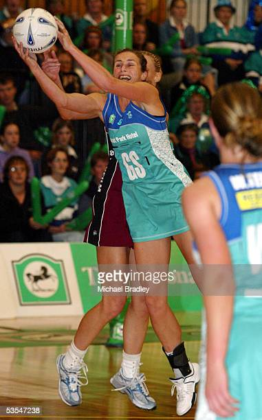 The Stings Tania Dalton secures the ball ahead of the Force's Kate Dowling during the National Bank Cup netball final between the Sting and the Force...