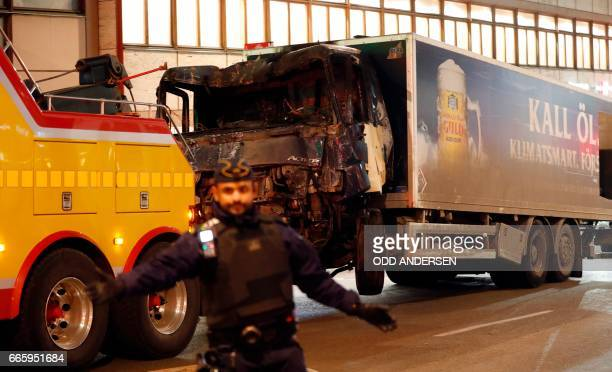 TOPSHOT The stolen truck which was driven through a crowd outside a department in Stockholm on April 7 is taken away on April 8 A massive manhunt was...