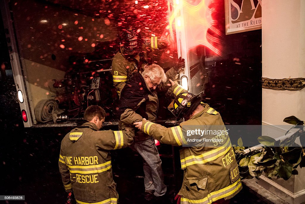 The Stone Harbor Fire and Rescue bring Phil Lazenby from Stone Harbor to the Reeds Hotel after evacuating him from his home in Stone Harbor New...