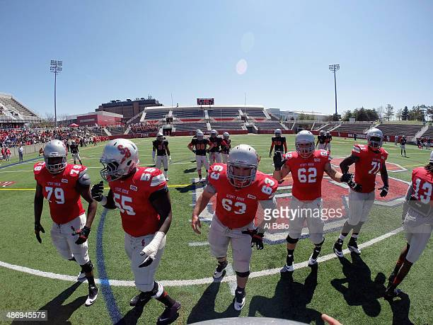 The Stony Brook Offense forms a huddle during their Spring Football Game at Kenneth P LaValle Stadium on April 26 2014 in Stony Brook New York