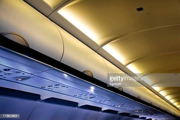 The storage compartments above your seat on a plane