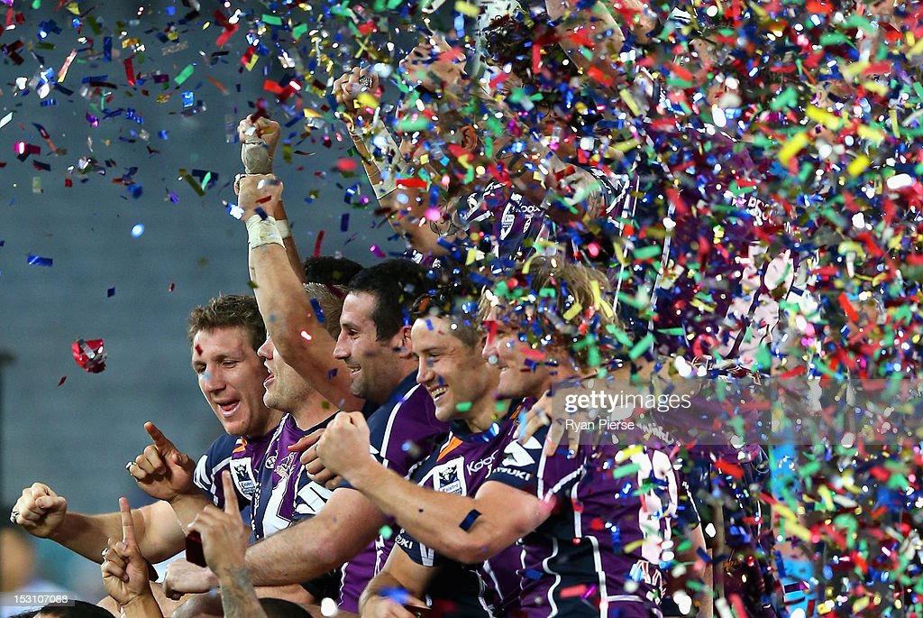 The Storm celebrate victory during the 2012 NRL Grand Final match between the Melbourne Storm and the Canterbury Bulldogs at ANZ Stadium on September 30, 2012 in Sydney, Australia.