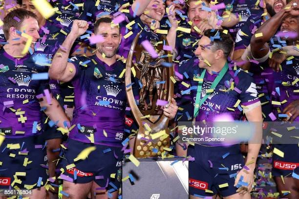 The Storm celebrate with the ProvanSummons Trophy after winning the 2017 NRL Grand Final match between the Melbourne Storm and the North Queensland...