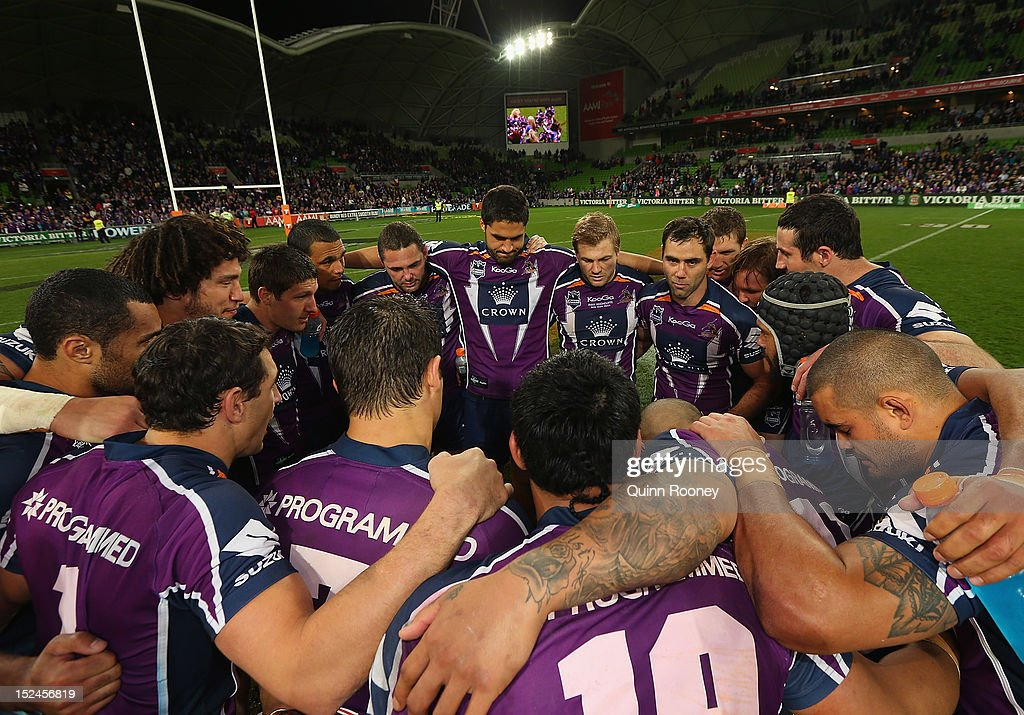 The Storm huddle in the middle of the ground after winning the NRL Preliminary Final match between the Melbourne Storm and the Manly Sea Eagles at AAMI Park on September 21, 2012 in Melbourne, Australia.