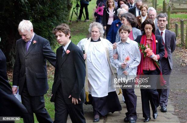 The Storrie family Graham and Luke with Mary and 13yearold Lawrence follow the coffin of Rosie May Storrie out of Bottesford Church Leicestershire...