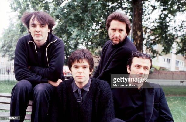 The Stranglers group portrait Primrose Hill London August 1980 Dave Greenfield JeanJacques Burnel Jet Black Hugh Cornwell