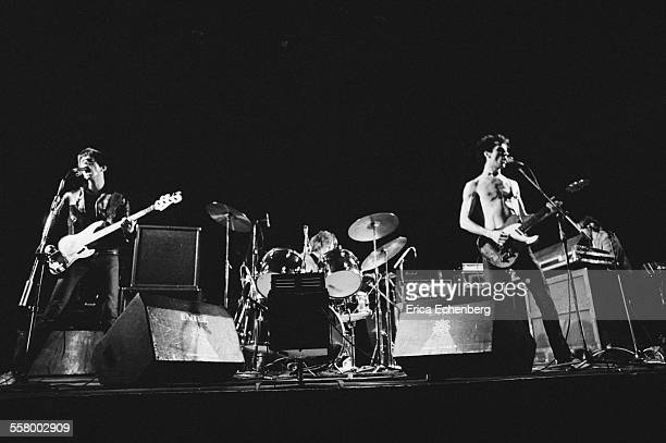 The Stranglers perform on stage at the Rainbow Theatre London United Kingdom 30th January 1977 LR JeanJacques Burnel Jet Black Hugh Cornwell and Dave...